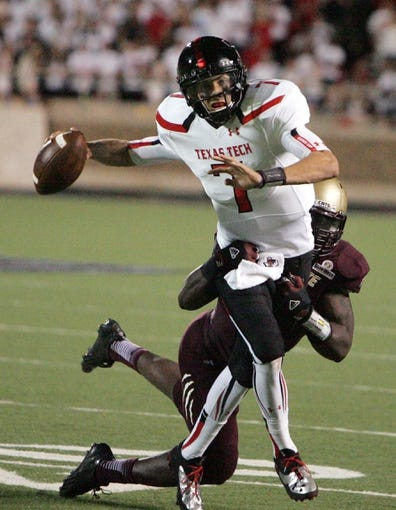 Sep 21, 2013; Lubbock, TX, USA; Texas Tech Red Raiders quarterback Davis Webb (7) is sacked by the Texas State Bobcats in the second half at Jones AT&T Stadium. Mandatory Credit: Michael C. Johnson-USA TODAY Sports