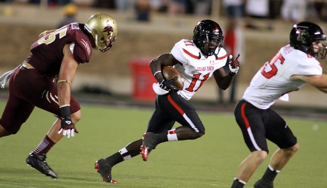 Sep 21, 2013; Lubbock, TX, USA; Texas Tech Red Raiders wide receiver Jakeem Grant (11) rushes against the Texas State Bobcats in the second half at Jones AT&T Stadium. Mandatory Credit: Michael C. Johnson-USA TODAY Sports