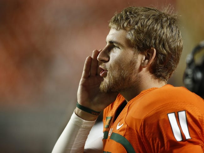 Sep 21, 2013; Miami Gardens, FL, USA;  Miami Hurricanes quarterback Ryan Williams (11) on the sideline in a game against the Savannah State Tigers in the second quarter at Sun Life Stadium. Mandatory Credit: Robert Mayer-USA TODAY Sports