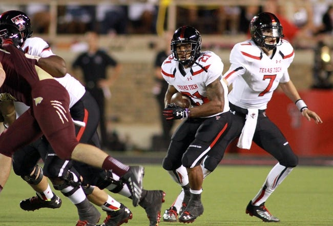 Sep 21, 2013; Lubbock, TX, USA; Texas Tech Red Raiders running back DeAndre Washington (21) rushes against the Texas State Bobcats in the second half at Jones AT&T Stadium. Mandatory Credit: Michael C. Johnson-USA TODAY Sports