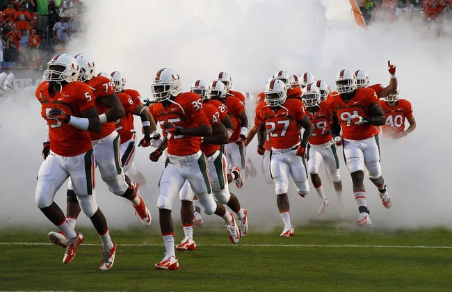 Sep 21, 2013; Miami Gardens, FL, USA;  The Miami Hurricanes enter the field before a game against the Savannah State Tigers at Sun Life Stadium. Mandatory Credit: Robert Mayer-USA TODAY Sports