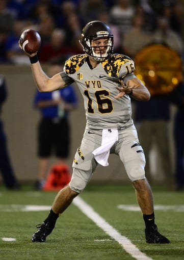 Sep 21, 2013; Colorado Springs, CO, USA; Wyoming Cowboys quarterback Brett Smith (16) prepares to pass against the Air Force Falcons in the first quarter at Falcon Stadium. Mandatory Credit: Ron Chenoy-USA TODAY Sports