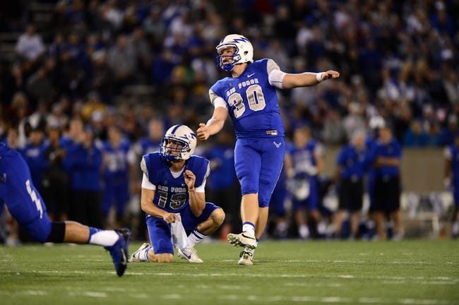 Sep 21, 2013; Colorado Springs, CO, USA; Air Force Falcons kicker Will Conant (30) completes a thirty three yard field goal as punter David Baska (19) holds against the Wyoming Cowboys in the first quarter at Falcon Stadium. Mandatory Credit: Ron Chenoy-USA TODAY Sports