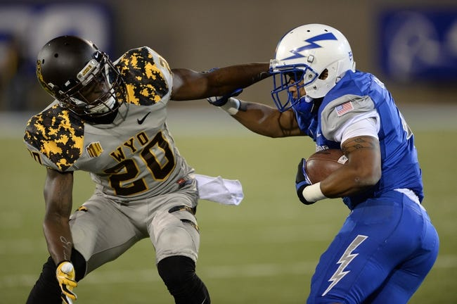 Sep 21, 2013; Colorado Springs, CO, USA; Wyoming Cowboys cornerback Blair Burns (20) tries to tackle Air Force Falcons wide receiver Sam Gagliano (4) after a catch in the first quarter at Falcon Stadium. Mandatory Credit: Ron Chenoy-USA TODAY Sports