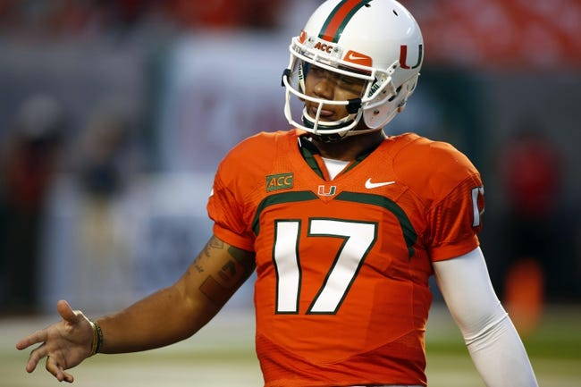 Sep 21, 2013; Miami Gardens, FL, USA; Miami Hurricanes quarterback Stephen Morris (17) after a touchdown in the first quarter of a game against the Savannah State Tigers at Sun Life Stadium. Mandatory Credit: Robert Mayer-USA TODAY Sports