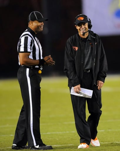 Sep 21, 2013; San Diego, CA, USA; Oregon State Beavers head coach Mike Riley laughs as he talks with a referee during the second half against the San Diego State Aztecs at Qualcomm Stadium. Mandatory Credit: Christopher Hanewinckel-USA TODAY Sports