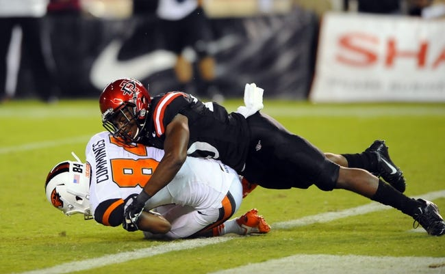 Sep 21, 2013; San Diego, CA, USA; Oregon State wide receiver Kevin Cummings (84) is tackled after scoring during the second half against the San Diego State Aztecs at Qualcomm Stadium. Mandatory Credit: Christopher Hanewinckel-USA TODAY Sports