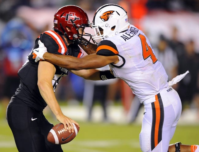 Sep 21, 2013; San Diego, CA, USA; San Diego State Aztecs quarterback Quinn Kaehler (18) is sacked by Oregon State Beavers linebacker D.J. Alexander (4) during the second half at Qualcomm Stadium. Mandatory Credit: Christopher Hanewinckel-USA TODAY Sports