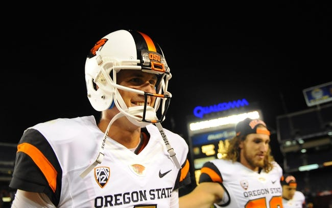 Sep 21, 2013; San Diego, CA, USA; Oregon State Beavers quarterback Sean Mannion (4) celebrates after a 34-30 win against the San Diego State Aztecs at Qualcomm Stadium. Mandatory Credit: Christopher Hanewinckel-USA TODAY Sports