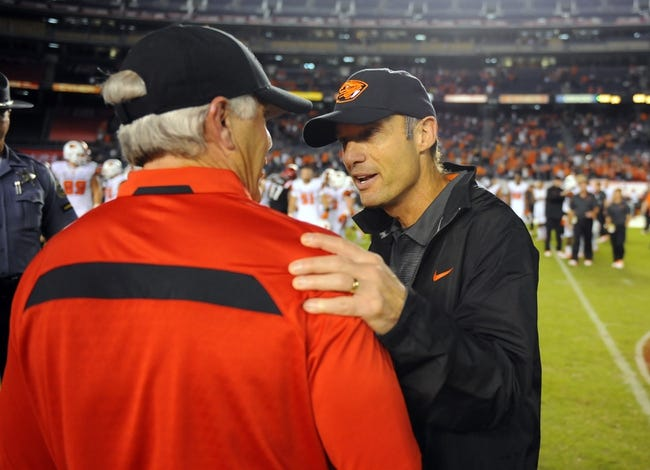 Sep 21, 2013; San Diego, CA, USA; San Diego State head coach Rocky Long (left) and Oregon State head coach Mike Riley (right) after a 34-30 win by the Beavers at Qualcomm Stadium. Mandatory Credit: Christopher Hanewinckel-USA TODAY Sports