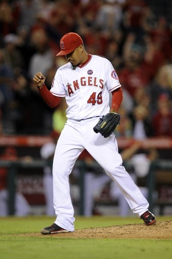 Sep 21, 2013; Anaheim, CA, USA; Los Angeles Angels pitcher Ernesto Frieri (49) celebrate after the game against the Seattle Mariners at Angel Stadium of Anaheim. The Los Angeles Angels defeated the Seattle Mariners 6-5. Mandatory Credit: Kelvin Kuo-USA TODAY Sports