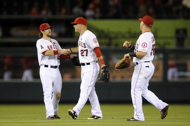 Sep 21, 2013; Anaheim, CA, USA; Los Angeles Angels left fielder Collin Cowgill (left), center fielder Mike Trout (center), and right fielder Kole Calhoun (right) celebrate after the game against the Seattle Mariners at Angel Stadium of Anaheim. The Los Angeles Angels defeated the Seattle Mariners 6-5. Mandatory Credit: Kelvin Kuo-USA TODAY Sports