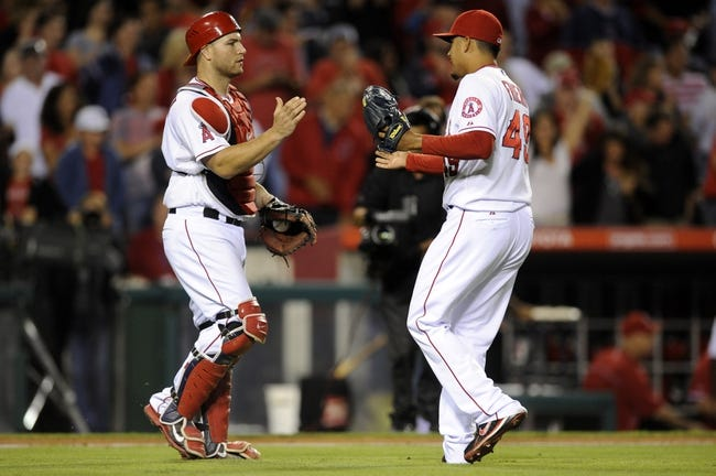 Sep 21, 2013; Anaheim, CA, USA; Los Angeles Angels pitcher Ernesto Frieri (49) celebrates with catcher Chris Iannetta (17) after the game against the Seattle Mariners at Angel Stadium of Anaheim. The Los Angeles Angels defeated the Seattle Mariners 6-5. Mandatory Credit: Kelvin Kuo-USA TODAY Sports