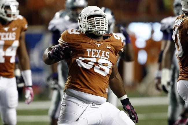 Sep 21, 2013; Austin, TX, USA; Texas Longhorns defensive tackle Desmond Jackson (99) reacts to an officials call during the fourth quarter of a football game against the Kansas State Wildcats at Darrell K Royal-Texas Memorial Stadium. The Longhorns won 31-21. Mandatory Credit: Jim Cowsert-USA TODAY Sports