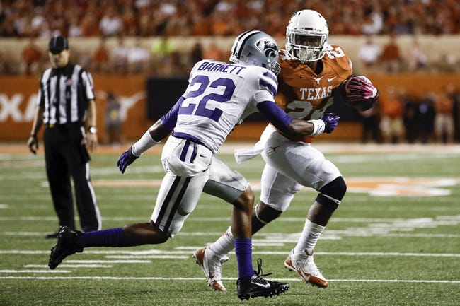 Sep 21, 2013; Austin, TX, USA; Texas Longhorns running back Joe Bergeron (24) runs against Kansas State Wildcats defensive back Dante Barnett (22) during the fourth quarter of a football game at Darrell K Royal-Texas Memorial Stadium. The Longhorns won 31-21. Mandatory Credit: Jim Cowsert-USA TODAY Sports