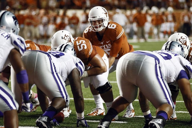 Sep 21, 2013; Austin, TX, USA; Texas Longhorns quarterback Case McCoy (6) prepares to take the snap from center Dominic Espinosa (55) against the Kansas State Wildcats during the fourth quarter of a football game at Darrell K Royal-Texas Memorial Stadium. The Longhorns won 31-21. Mandatory Credit: Jim Cowsert-USA TODAY Sports