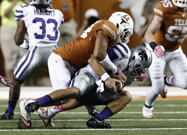 Sep 21, 2013; Austin, TX, USA; Texas Longhorns defensive end Jackson Jeffcoat (44) sacks Kansas State Wildcats quarterback Jake Waters (15) during the fourth quarter of a football game at Darrell K Royal-Texas Memorial Stadium. The Longhorns won 31-21. Mandatory Credit: Jim Cowsert-USA TODAY Sports