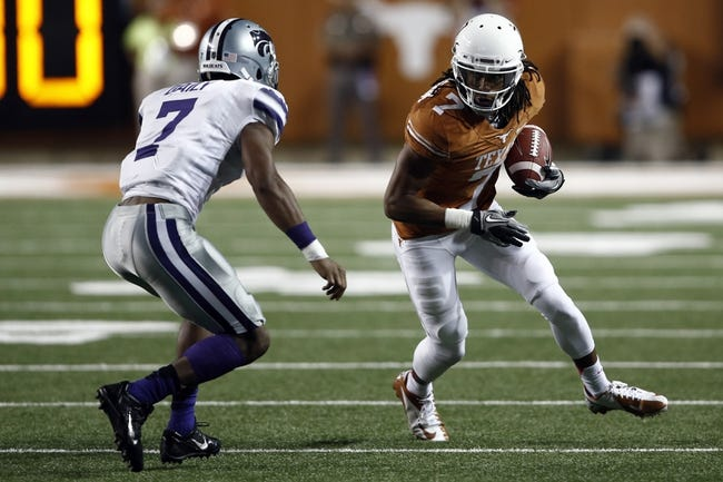 Sep 21, 2013; Austin, TX, USA; Texas Longhorns wide receiver Marcus Johnson (7) runs against Kansas State Wildcats defensive back Kip Daily (7) during the fourth quarter of a football game at Darrell K Royal-Texas Memorial Stadium. The Longhorns won 31-21. Mandatory Credit: Jim Cowsert-USA TODAY Sports