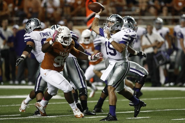 Sep 21, 2013; Austin, TX, USA; Kansas State Wildcats quarterback Jake Waters (15) throws under pressure by Texas Longhorns defensive tackle Malcom Brown (90) during the fourth quarter of a football game at Darrell K Royal-Texas Memorial Stadium. The Longhorns won 31-21. Mandatory Credit: Jim Cowsert-USA TODAY Sports