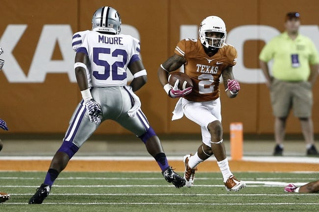 Sep 21, 2013; Austin, TX, USA; Texas Longhorns wide receiver Kendall Sanders (2) rushes against Kansas State Wildcats linebacker Charmeachealle Moore (52) during the fourth quarter of a football game at Darrell K Royal-Texas Memorial Stadium. The Longhorns won 31-21. Mandatory Credit: Jim Cowsert-USA TODAY Sports