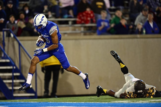 Sep 21, 2013; Colorado Springs, CO, USA; Air Force Falcons wide receiver Jalen Robinette (9) scores on a thirty eight yard touchdown reception as Wyoming Cowboys defensive back Tim Hayes (29) defends in the fourth quarter at Falcon Stadium. Mandatory Credit: Ron Chenoy-USA TODAY Sports