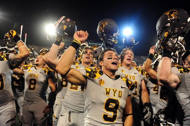 Sep 21, 2013; Colorado Springs, CO, USA; Members of the Wyoming Cowboys react to the win over the Air Force Falcons at Falcon Stadium. The Cowboys defeated the Falcons 56-23. Mandatory Credit: Ron Chenoy-USA TODAY Sports