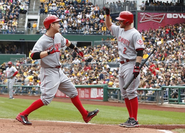 Sep 22, 2013; Pittsburgh, PA, USA; Cincinnati Reds third baseman Todd Frazier (21) is greeted at home plate by shortstop Zack Cozart (2) after Frazier hit a two run home run against the Pittsburgh Pirates during the first inning at PNC Park. Mandatory Credit: Charles LeClaire-USA TODAY Sports