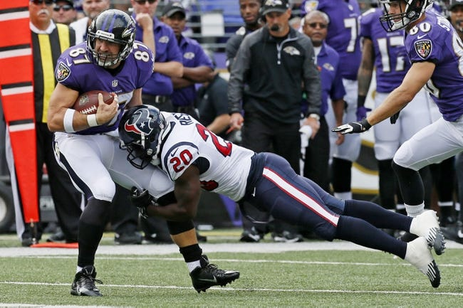 Sep 22, 2013; Baltimore, MD, USA; Houston Texans safety Ed Reed (20) tackles Baltimore Ravens tight end Dallas Clark (87) following his catch and run at M&T Bank Stadium. Mandatory Credit: Mitch Stringer-USA TODAY Sports