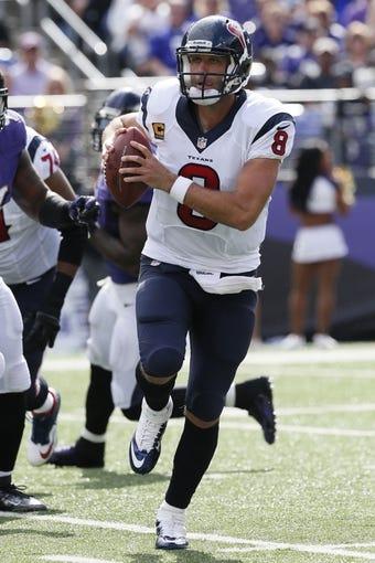 Sep 22, 2013; Baltimore, MD, USA; Houston Texans quarterback Matt Schaub (8) runs to escape pressure from the Baltimore Ravens at M&T Bank Stadium. Mandatory Credit: Mitch Stringer-USA TODAY Sports