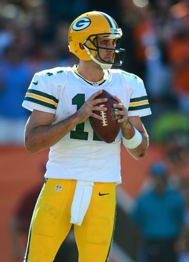 Sep 22, 2013; Cincinnati, OH, USA; Green Bay Packers quarterback Aaron Rodgers (12) looks to throw a pass during the fourth quarter against the Cincinnati Bengals at Paul Brown Stadium. Mandatory Credit: Andrew Weber-USA TODAY Sports
