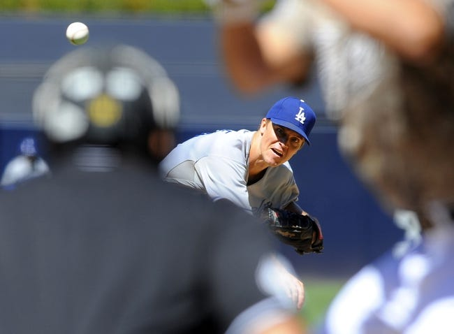 Sep 22, 2013; San Diego, CA, USA; Los Angeles Dodgers starting pitcher Zack Greinke (21) throws during the first inning against the San Diego Padres at Petco Park. Mandatory Credit: Christopher Hanewinckel-USA TODAY Sports