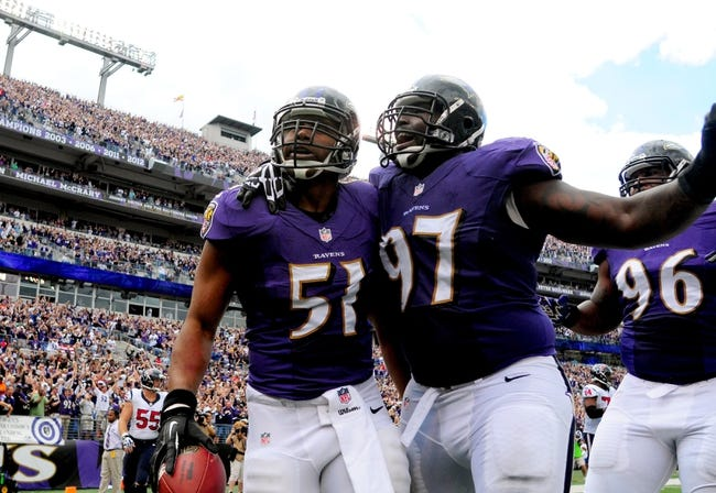 Sep 22, 2013; Baltimore, MD, USA; Baltimore Ravens linebacker Daryl Smith (51) is congratulated by defensive tackle Arthur Jones (97) after returning an interception for a touchdown in the second quarter against the Houston Texans at M&T Bank Stadium. Mandatory Credit: Evan Habeeb-USA TODAY Sports