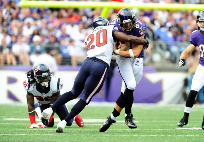 Sep 22, 2013; Baltimore, MD, USA; Baltimore Ravens tight end Dallas Clark (87) is tackled by Houston Texans safety Ed Reed (20) at M&T Bank Stadium. Mandatory Credit: Evan Habeeb-USA TODAY Sports