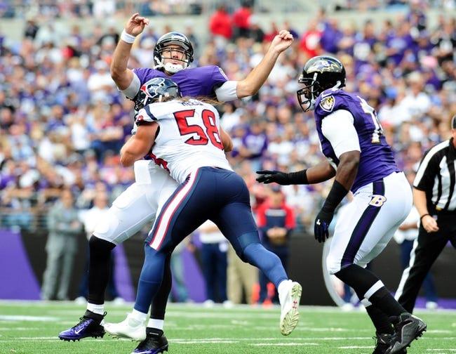Sep 22, 2013; Baltimore, MD, USA; Houston Texans linebacker Brooks Reed (58) hits Baltimore Ravens quarterback Joe Flacco (5) at M&T Bank Stadium. Mandatory Credit: Evan Habeeb-USA TODAY Sports