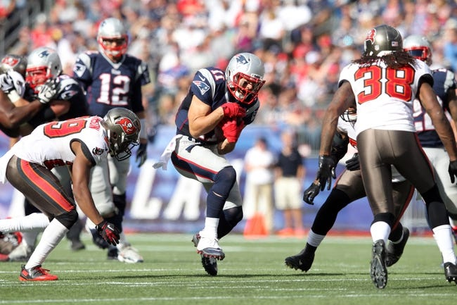 Sep 22, 2013; Foxborough, MA, USA; New England Patriots wide receiver Julian Edelman (11) makes a reception against the Tampa Bay Buccaneers during the fourth quarter of a game at Gillette Stadium. The Patriots defeated the Buccaneers 23-3. Mandatory Credit: Brad Penner-USA TODAY Sports