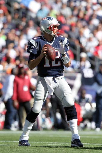 Sep 22, 2013; Foxborough, MA, USA; New England Patriots quarterback Tom Brady (12) drops back to pass against the Tampa Bay Buccaneers during the second quarter of a game at Gillette Stadium. Mandatory Credit: Brad Penner-USA TODAY Sports