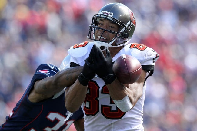 Sep 22, 2013; Foxborough, MA, USA; Tampa Bay Buccaneers wide receiver Vincent Jackson (83) drops a pass defended by New England Patriots corner back Aqib Talib (31) during the second quarter of a game at Gillette Stadium. Mandatory Credit: Brad Penner-USA TODAY Sports