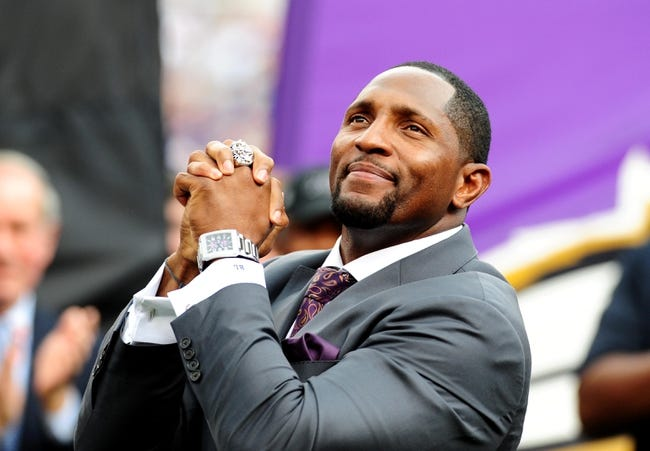 Sep 22, 2013; Baltimore, MD, USA; Former Baltimore Ravens linebacker Ray Lewis acknowledges the crowd during halftime of the game against the Houston Texans at M&T Bank Stadium. Mandatory Credit: Evan Habeeb-USA TODAY Sports