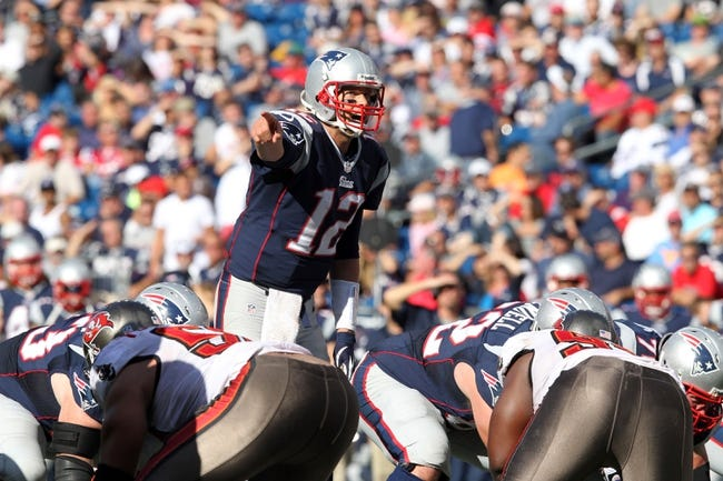 Sep 22, 2013; Foxborough, MA, USA; New England Patriots quarterback Tom Brady (12) calls a play at the line against the Tampa Bay Buccaneers during the fourth quarter of a game at Gillette Stadium. The Patriots defeated the Buccaneers 23-3. Mandatory Credit: Brad Penner-USA TODAY Sports