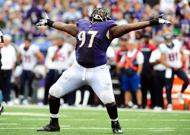 Sep 22, 2013; Baltimore, MD, USA; Baltimore Ravens defensive tackle Arthur Jones (97) celebrates after recording a sack in the fourth quarter against the Houston Texans at M&T Bank Stadium. Mandatory Credit: Evan Habeeb-USA TODAY Sports