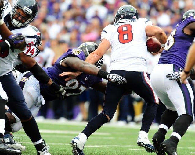 Sep 22, 2013; Baltimore, MD, USA; Houston Texans quarterback Matt Schaub (8) is sacked by Baltimore Ravens defensive tackle Arthur Jones (97) at M&T Bank Stadium. Mandatory Credit: Evan Habeeb-USA TODAY Sports