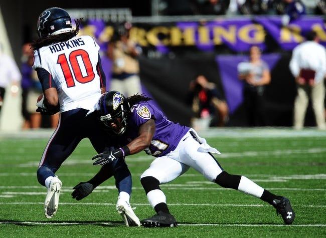 Sep 22, 2013; Baltimore, MD, USA; Houston Texans wide receiver DeAndre Hopkins (10) gets tackled by Baltimore Ravens cornerback Lardarius Webb (21) at M&T Bank Stadium. Mandatory Credit: Evan Habeeb-USA TODAY Sports