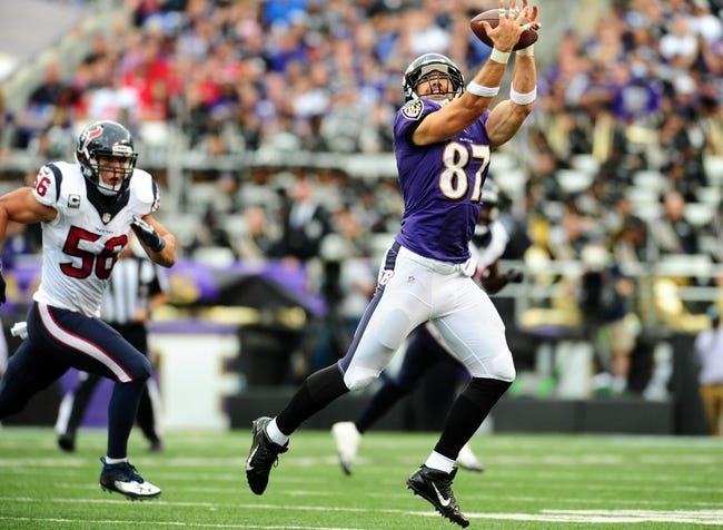 Sep 22, 2013; Baltimore, MD, USA; Baltimore Ravens tight end Dallas Clark (87) catches a pass in front of Houston Texans linebacker Brian Cushing (56) at M&T Bank Stadium. Mandatory Credit: Evan Habeeb-USA TODAY Sports