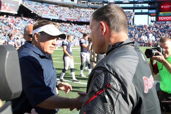 Sep 22, 2013; Foxborough, MA, USA; New England Patriots head coach Bill Belichick (left) shakes hands with Tampa Bay Buccaneers head coach Greg Schiano following the fourth quarter of a game at Gillette Stadium. The Patriots defeated the Buccaneers 23-3. Mandatory Credit: Brad Penner-USA TODAY Sports