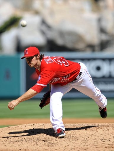 September 22, 2013; Anaheim, CA, USA; Los Angeles Angels starting pitcher C.J. Wilson (33) pitches during the third inning against the Seattle Mariners at Angel Stadium of Anaheim. Mandatory Credit: Gary A. Vasquez-USA TODAY Sports