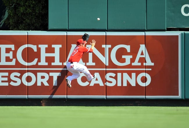September 22, 2013; Anaheim, CA, USA; Los Angeles Angels center fielder Mike Trout (27) misses catching a fly ball in the first inning against the Seattle Mariners at Angel Stadium of Anaheim. Mandatory Credit: Gary A. Vasquez-USA TODAY Sports