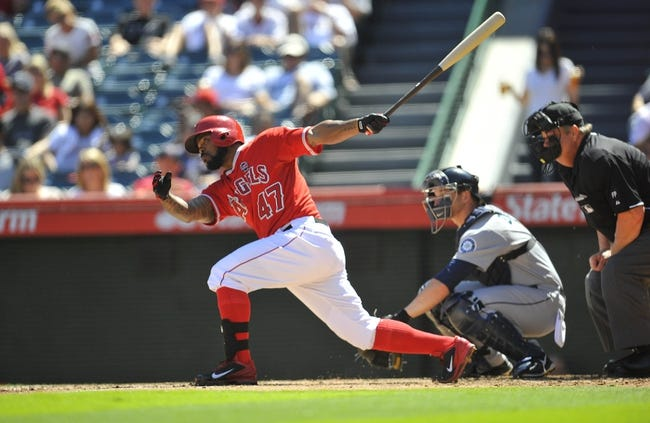 September 22, 2013; Anaheim, CA, USA; Los Angeles Angels second baseman Howie Kendrick (47) hits a double during the second inning against the Seattle Mariners at Angel Stadium of Anaheim. Mandatory Credit: Gary A. Vasquez-USA TODAY Sports