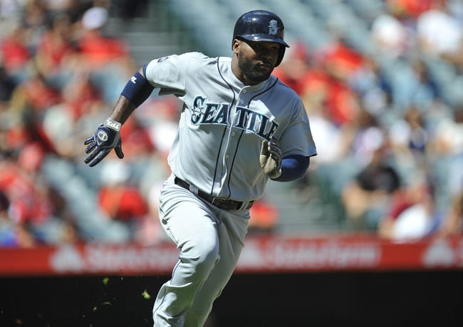September 22, 2013; Anaheim, CA, USA; Seattle Mariners center fielder Abraham Almonte (36) runs after hitting a single during the first inning against the Los Angeles Angels at Angel Stadium of Anaheim. Mandatory Credit: Gary A. Vasquez-USA TODAY Sports