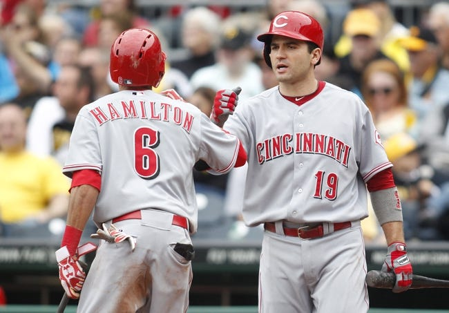 Sep 22, 2013; Pittsburgh, PA, USA; Cincinnati Reds center fielder Billy Hamilton (6) is greeted at home plate by first baseman Joey Votto (19) after scoring against the Pittsburgh Pirates during the eighth inning at PNC Park.  The Reds won 11-3. Mandatory Credit: Charles LeClaire-USA TODAY Sports