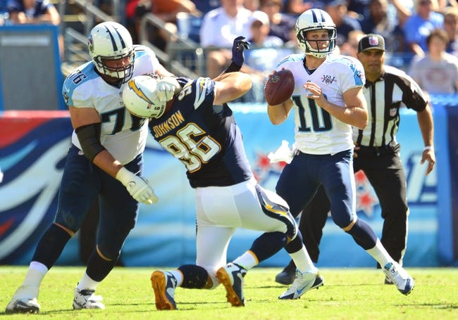 Sep 22, 2013; Nashville, TN, USA; Tennessee Titans tackle David Stewart (76) blocks San Diego Chargers linebacker Jarret Johnson (96) during the second half at LP Field. The Titans beat the Chargers 20-17. Mandatory Credit: Don McPeak-USA TODAY Sports